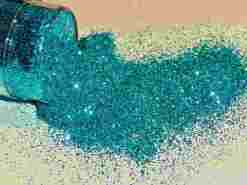 turquoise colored glitter spilled out