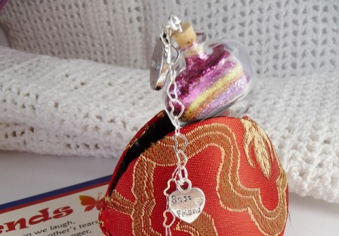 best friend wish vessel sticking out of a orange chinese coin purse