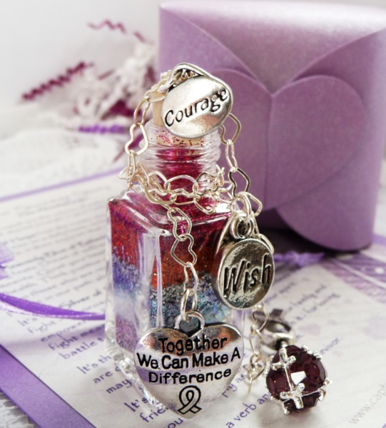 Together we can make a difference charm on a unique wish vessel for cancer patients