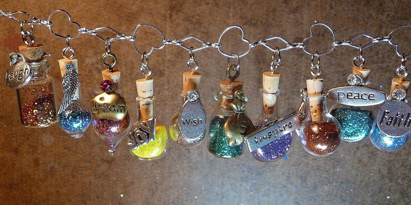 chained wishes in miniature bottles