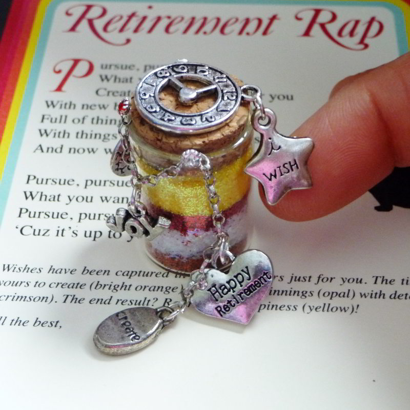 closeup of retirement wish vessel with Happy Retirement charm