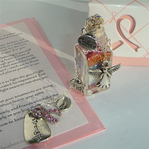 Breast cancer success story wish vessel beside verse card with themed charms