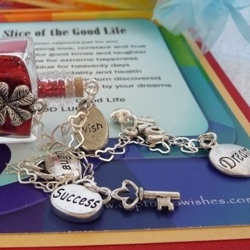 Slice of the good life good luck themed charms on a colorful verse card
