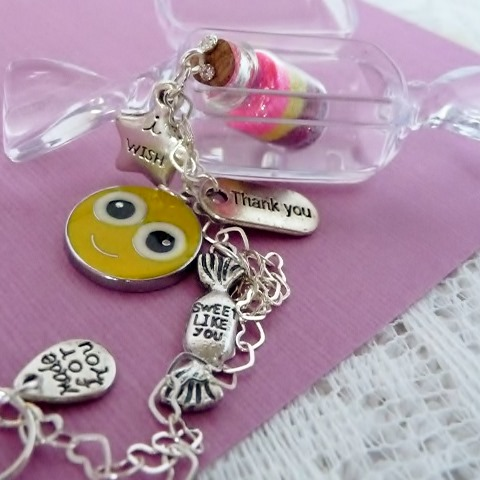 Smiley face charm with candy charm, thank you charm and tiny little wish vessel