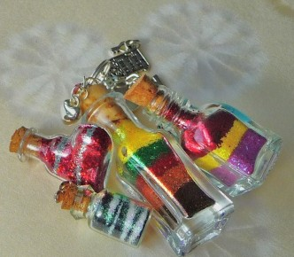 Four little wish bottles with layers of pixie dust